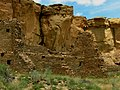 Cliff face and stone walls at Chaco Culture National Historic Park.jpg
