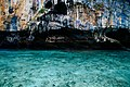 Colorful rock face by the water (Unsplash).jpg