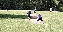 Men playing baseball in vintage uniforms