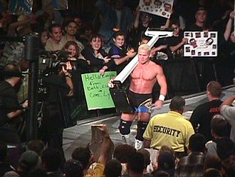 Crash Holly - Holly carrying his weighing scale to the ring in 1999