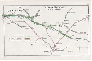 "Bingham Road railway station - A 1908 Railway Clearing House map of part the Woodside and South Croydon Railway, showing the surrounding lines. The map has north on the right. Bingham Road Halt was just above the ""W"" of Woodside."