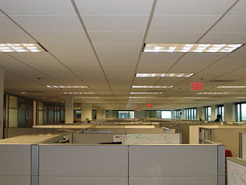 English: An image of a lot of cubicles that se...