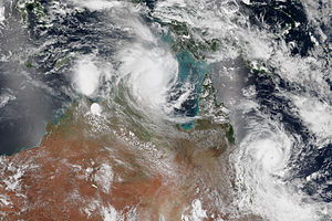 Cyclone Marcia - Satellite image of Lam (top-center) and Marcia (right) making near-simultaneous landfalls