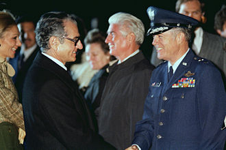 Iran–United States relations - Mohammed Reza Pahlavi, Shah of Iran, shakes hands with a US Air Force general officer prior to his departure from the United States