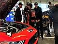 Daniel in the garage with crew.jpg