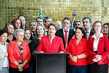 The former president of Brazil, Dilma Rousseff, surrounded by supporters, giving a speech