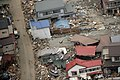 Destroyed houses and debris rest in a Japanese neighborhood (5550027638).jpg