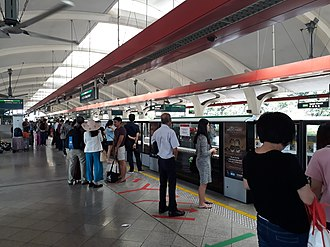 Tanah Merah MRT station - Passengers at Platform C of this station waiting for the Airport- bound train Changi Airport station.