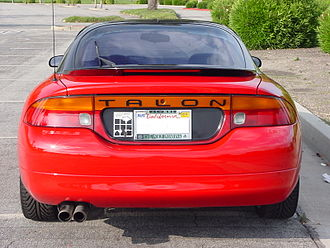 Eagle Talon - 1995 Eagle Talon TSi. Amber turn signals, integrated reverse lights, and bumper cap comprise the rear fascia that is unique to the Eagle Talon.