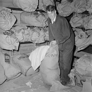 Commonwealth Trans-Antarctic Expedition - Edmund Hillary packs a sack in preparation for the expedition, Lower Hutt, New Zealand, 1956.