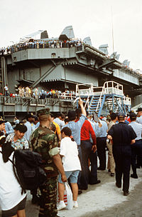 Evacuees from Mount Pinatubo board the USS Abraham Lincoln
