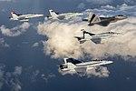 F-22A Raptor and four U.S. Marine Corps FA-18C Hornets in flight over the Southern California coast on 6 February 2019 (190206-M-BG453-1225).JPG