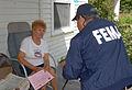 FEMA - 30683 - FEMA Community Relations worker talks to resident.jpg