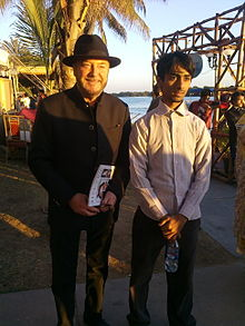 Faizan Munawar Varya with George Galloway.jpg