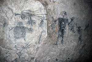 Lelepa Island - Cave Painting Cave in Rock. The right figure is often identified with Chief Roi Mata