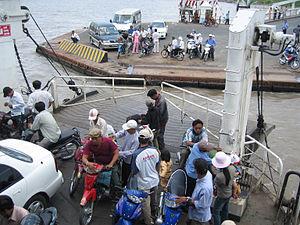 Ferry terminal on Mekong river.jpg