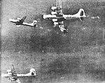 Fighter aircraft making a pass under a B-29.jpg