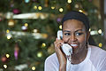 First Lady Michelle Obama discusses Santa's journey with children as part of the annual NORAD Tracks Santa program, December 24, 2014.jpg