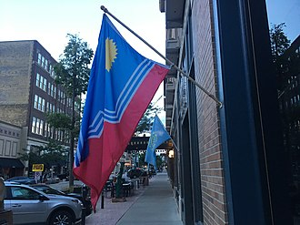 Flag of Sioux Falls, South Dakota - A flag of Sioux Falls flying in Downtown Sioux Falls, with a flag of South Dakota in the background