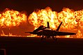Flames explode behind the U.S. Navy Blue Angels' F-A-18 Hornets during the night portion of the 2014 Miramar Air Show.jpg