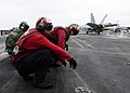 Flickr - Official U.S. Navy Imagery - Sailors wait for a jet..jpg