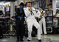 Flickr - Official U.S. Navy Imagery - a vocalist and and a performer from the Royal Malaysian navy's, Blue Wave Band perform together..jpg