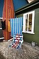 Folding chair and surfboard at a beach house, Auckland - 0999.jpg