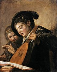 Two singing boys with a lute and a music book