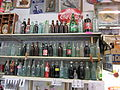 Ft Walton Shop bottle shelves.JPG