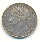 Half-Crown of George IV, 1821. The inscription reads GEORGIUS IIII D[ei] G[ratia] BRITANNIAR[um] REX F[idei] D[efensor] (George IV, by the grace of God King of the Britains (British kingdoms), Defender of the Faith). George IV was the last British King to be shown on coins wearing a Roman-style laurel wreath.