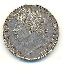 Half-Crown-Münze von 1821. Die Inschrift lautet GEORGIUS IIII D[ei] G[ratia] BRITANNIAR[um] REX F[idei] D[efensor] (Georg IV., durch die Gnade Gottes König der Britannier, Verteidiger des Glaubens). Georg IV. war der letzte britische Monarch, der auf Münzen im römischen Stil mit einem Lorbeerzweig abgebildet wurde. (Quelle: Wikimedia)