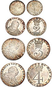 Four small silver coins, shown as a set and with both sides visible