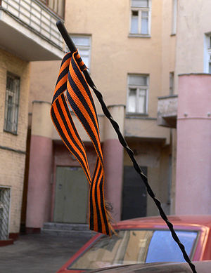 Awareness ribbon - The striped Ribbon of Saint George, seen tied to a car in Moscow, is a symbol of military valour in Russia, widely associated with Russian patriotism.