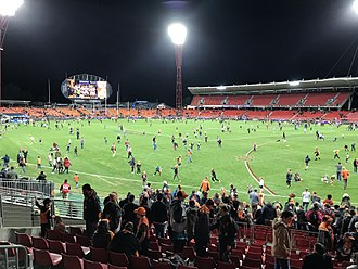 Sydney Showground Stadium - Patrons play on the surface of the stadium after an AFL game