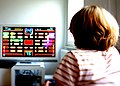 Girl plays Pac Man.JPG