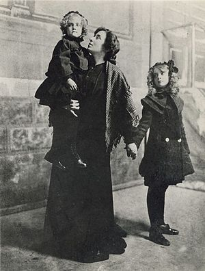 Mary Gish - Mary Gish carries her daughter Dorothy and holds her older daughter Lillian by the hand, 1900