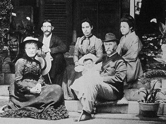 Thomas Blake Glover - Glover (holding grandson) and family, circa 1900