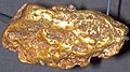 Gold fluvial cobble (placer gold) 4 (16827174857).jpg