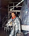 Gordon Cooper besides Mercury spacecraft.jpg