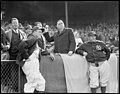 Gov. Hurley throws out the first ball as Joe Cronin and McCarthy watch, at Fenway.jpg