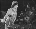 Grace Janota, former department store clerk, is now a lathe operator at a Western aircraft plant producing B-24... - NARA - 196370.tif