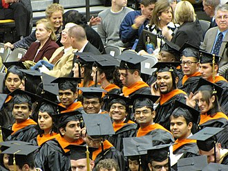 Honor society - Multi-colored tassels, cords and stoles are noticeable over black graduation robes.