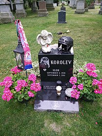 Gravestone of Igor Korolev in Mount Pleasant cemetery, Toronto, decorated with flowers and memorabilia