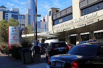 Hennepin County Medical Center - Main entrance at midday on a weekday. Hennepin Healthcare covers six city blocks.