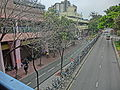 HK 上水 Sheung Shui 新運路 San Wan Road Feb-2014 view from MTR Station rainy day bike parking.JPG