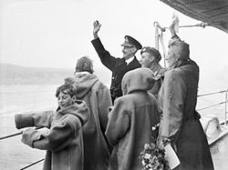 The royal family of Norway waving to the welcoming crowds from HMS Norfolk at Oslo.