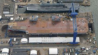 HMS Queen Elizabeth (R08) - Queen Elizabeth alongside Illustrious on the day of her naming ceremony
