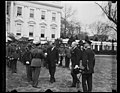 Herbert Hoover and military band outside White House, Washington, D.C. LCCN2016889238.jpg