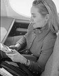 Hillary Rodham Clinton on plane using Game Boy (05).jpg
