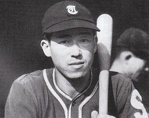 Ohshita in uniform with bat, age 24